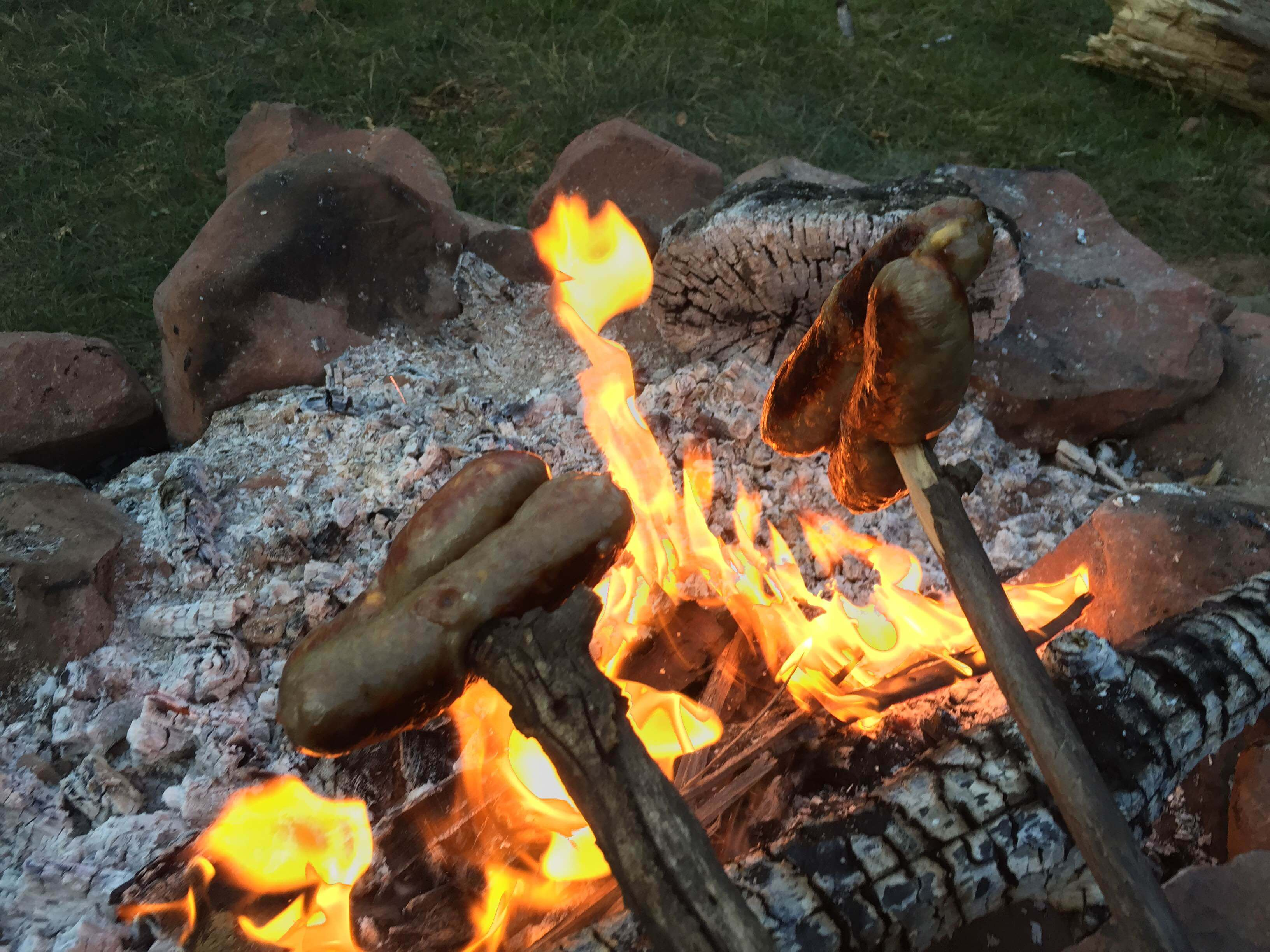 Roasting Brats Over A Campfire